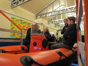 Radio and coordinates practice with the GPS and radio in boathouse.